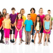 Large group of children singing.